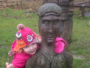 Girl with statue at Brierley Forest Park
